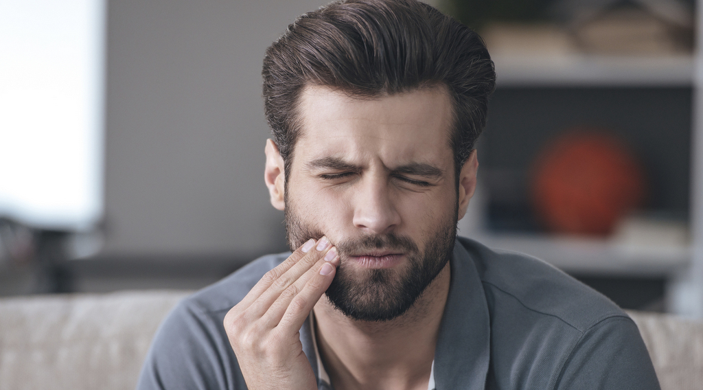 man with tooth ache